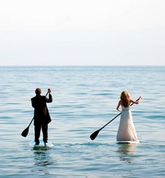bride and groom paddleboarding! This is a first.