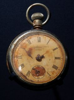 A pocket watch displaying the time ten minutes to two, which was recovered from the body of Titanic steward Sidney Sedunary, is displayed at the museum's Titanic exhibition on April 3, 2012 in Southampton, England.    Read more: http://www.nydailynews.com/news/titanic-sinking-100-years-rms-titanic-artifacts-auctioned-gallery-1.1058798#ixzz1tirQ2tMp