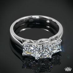 """Past Present and Future: 3 Stone """"Trellis"""" Diamond Engagement Ring set in platinum, features two 0.50ct Asscher Cut Diamonds on either side of a beautiful 1.2ct Asscher Cut Diamond."""
