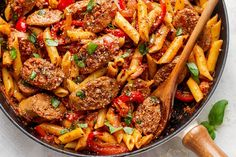 20-Minute Sausage Pasta Skillet — A quick and easy skillet meal with incredible flavor, perfect for weeknight dinners with family. Delicious chunks of Italian sausage are combined with tomato garli…