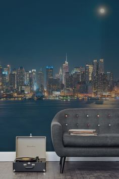 Fall in love with this dazzling view of New York city under the glowing moon. Deep blue tones of the sky and the water bring a calming atmosphere to your home. Whilst the twinkling lights of New York's impeccable skyline pierce through, giving a beautiful contrast. Perfect for living room spaces after a sophisticated feel to their interiors.