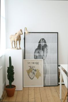 Carl's art collection lines the walls throughout his London flat.