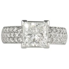 Milky Way Pave Engagement Ring - This diamond engagement ring twinkles like the Milky Way. Three rows of pave set diamonds adorn the sides. The bottom of the ring shown is set with birthstones creating a constellation. Set with a Firemark princess cut diamond. Ideal cut accent diamonds.