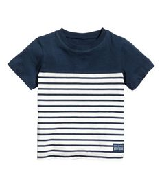 Dark blue/white striped. T-shirt in soft jersey with a printed design.
