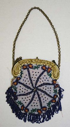 Purse Date: 1840s Culture: German Medium: metal, glass, silk Dimensions: Length: 10 3/8 in. (26.4 cm) Credit Line: Gift of Stella Jolles Reichman, 1980 Accession Number: 1980.445.7