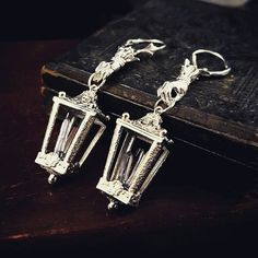 Charon's Lantern earrings and amulet. ♡