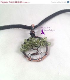 https://www.etsy.com/listing/207285665/mini-tree-of-life-necklace-with-peridot
