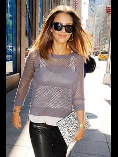 731d1585e00 The brunette beauty topped off her fall look with a sheer sweater and tank.