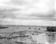 DUKW amphibious trucks of the 470th Amphibious Truck Company, First Engineer Brigade, bringing supplies to Utah Beach from ships anchored of...