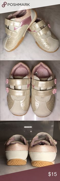 New Baby shoes by Circo with 2 Velcro strapped These are adorable Baby shoes made from man made materials and adored with pretty pink flowers and metallic checking in the back of the shoe else well as a pink metallic material so in the center of the shoe. The bottoms are made of rubber. Circo Shoes Sneakers