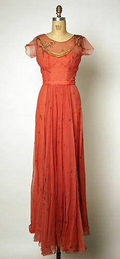 Evening dress - Front Designer: Attributed to Gilbert Adrian (American, Naugatuck, Connecticut 1903–1959 Hollywood, California) Date: late 1940s Culture: American Medium: silk Dimensions: [no dimensions available] Credit Line: Gift of David Walker Campbell.