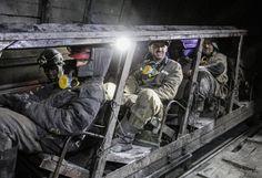 Miners sitting in a mine wagon in the Kirov mine