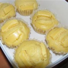Puto 4 cups all-purpose flour 2 cups white sugar 1 tablespoon baking powder 6 eggs 1 (12 fluid ounce) can evaporated milk 1 1/2 cups water 2 1/4 cups Edam cheese, shredded