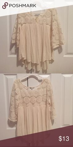 Cream colored fancy shirt The top part and sleeves have laced flowers and the bottom of the shirt is a solid cream thin fabric. Sleeves are about half length of arm. American Eagle Outfitters Tops Blouses