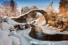 Packhorse Bridge Taken in a little village called Carrbridge near Aviemore in the Highlands of Scotland by John Taggart