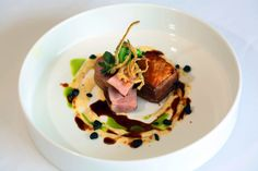 Asian spiced pork belly confit with pork tenderloin, coconut chili puree, lime tempura, Choi sum and galangal pork jus