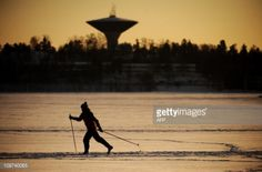 A woman goes cross-country skiing on the ice outside Helsinki,... #utsjoki: A woman goes cross-country skiing on the ice outside… #utsjoki