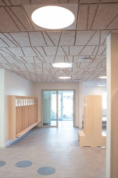 The ceiling of this childcare institution is gently selected to create visual effects and a calm atmosphere. The design is a combination of Troldtekt tilt line and Troldtekt acoustic panels combining aesthetics with great sound. Click the picture to check out the full gallery of the institution Frijsenborgvej. #goodacoustics #holzwolleplatten #träullsplattor #troldtekt Architects: Arkitekter Johansen & Rasmussen Activity Room, Sound Absorbing, Acoustic Panels, Through The Window, Wall Cladding, Visual Effects, Tilt, Childcare, Architects