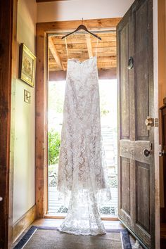 A peaceful country way to showcase a #wedding #gown | C. Tyler Corvin Studio    Perhaps hanging your wedding dress in a doorway to frame it.   Loving this shot.