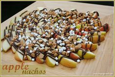 Peanut Butter Nutella Apple Nachos = Delish! ◾large apples, sliced, lemon juice concentrate, Nutella, peanut butter morsels, mini marshmallow bits
