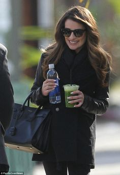 Is that your secret? Lea Michele glows as she leaves a photo shoot with a healthy vegetable drink in hand