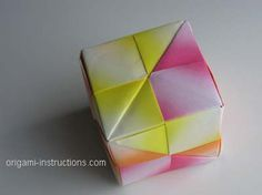 Origami cube. After you've made a few of these, they come together fast, and are fun to make while watching tv or listening to music. i filled several with small presents and tissue paper for a fun gift presentation