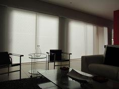 Sistema de paneles en sala, en Santa Rosa, casas del parque.