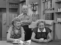 I Love Lucy (1951) Lucy and Ethel laugh at Fred who is looking for his eyeglasses that he can;t find despite being on top of his head.