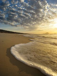 Sunrise on the beach in Canelones, Uruguay. Canelones is the capital of the department of Canelones. Its name is derived from a species of cinnamon, which is called 'canelón,' growing along the banks of the Canelon River.