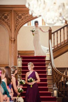 Bridal flowers by Eden Blooms. Bride walking down stairs at Froyle Park. Bouquet made of Purple, Picasso and White Calla Lily. Image taken by Claire Lau Photography.