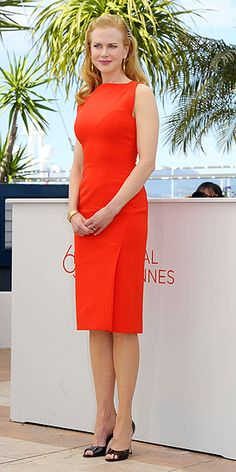 NICOLE KIDMAN  After coordinating looks with her Hemingway & Gellhorn costar Clive Owen, Nicole flies solo in a stunning form-fitting orange-red dress at a photocall for her other new flick, The Paperboy.