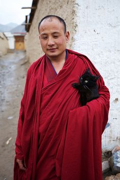 Monk with his cat..   ..........what a great picture!