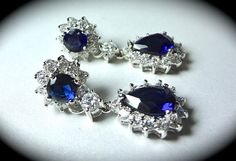 These beautiful halo blue sapphire colored cubic zirconias are inspired by Princess Kate Middleton. They sparkle like crazy! They are perfect