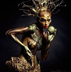 """A Dryad is a tree nymph, that is a female spirit of a tree, in Greek mythology. In Greek drys signifies """"oak"""". Thus dryads are specifically the nymphs of oak trees,though the term has come to be used for all tree nymphs in general."""