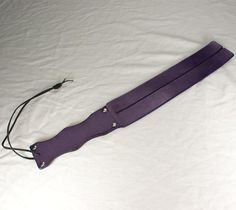 A tawse. Favorited by Destiny, the heroine in Destiny's Chance, a reincarnation romance with erotic spanking. Razor Strop, Scottish Fashion, Important Things In Life, Cool Toys, Initials, Buy And Sell, Leather, Stuff To Buy, Paddles