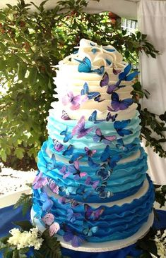 Beautiful Ombre Cake Ideas For All Occasions - Blue and Purple butterfly tier cake made by Carey's Cakery & Bake Shop | CraftyMorning.com