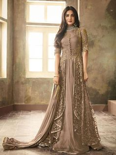 Buy Latest Indian Designer Wedding Anarkali Suit. The Anarkali suit is made up of a long, frock-style top and features a slim fitted bottom. The Anarkali suit varies in many different lengths and embroideries including floor-length Anarkali styles. Bollywood Anarkalis inTrend #anarkalisuits #designed#net#mauve#sonalchahan Eid Dresses, Indian Gowns Dresses, Party Wear Dresses, Pakistani Dresses, Bridal Dresses, Indian Anarkali, Party Wear Lehenga, Flapper Dresses, Party Gowns