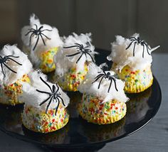 Hundreds and thousands give these frightful muffins a colourful speckled effect. Top with candy floss webs and a toy spider to complete the look.
