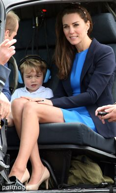 Prince George and the Duke and Duchess of Cambridge in a helicopter during a visit to RAF Fairford