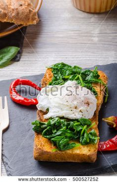 Toasted baguette with poached egg and garlic spinach