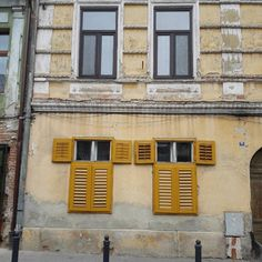 "I call these the ""Dancing Windows"" you can find them on one of the most beautifuk streets in my hometown #Sibiu #Romania #hometown #Europe #travel #traveler #instatravel #travelgram #great #nice #beautiful #amazing #awesome #windows #architecture #design #vintage #building #citycentre #yellow #old #discover #nofilter #open"