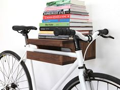 Six Awesome Bike Accessories [From a wine-carrier to a very stylish padlock, these bike accessories will steer your two-wheeled steed down the right path. Here are six bike accessories to make all your mates jealous. 1. Storage Don't ditch your ride in the hallway — or unthinkably, outside. Make a feature of it with this dead-useful, dead-handsome. Original bike shelf, approx. $283, available from theknifeandsaw.com.]