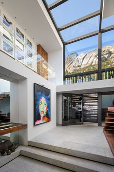 Stepping inside this modern house, double-height ceilings and windows that wrap around from the wall to the ceiling create a sense of openness and a dramatic entryway. Home Room Design, Dream Home Design, Home Interior Design, New Modern House, Modern House Design, Villa Design, Dream House Interior, Beautiful Interior Design, House Rooms