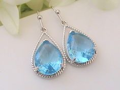 A subtle and delicate complement to any wedding gown, these amazing ocean inspired silver fancy aqua drop earrings are the perfect bridal jewelry accent for a beach wedding.