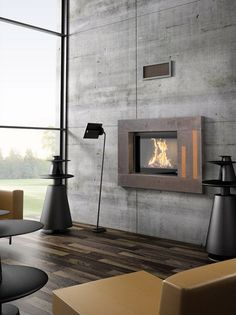 Modern fireplace by Cheminée-Calhao- mount reg exisitng tv on wall & build with wood around it