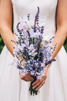 wildflower wedding bouquets the bride is holding a bouquet with delicate flowers and lavender cassandra lane photography #weddingbouquets #weddingflowers