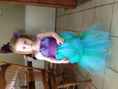 Little mermaid costume! 6in crochet head band, colored tulle of your choice, tie the tulle around the headband, voila!