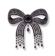ONYX AND DIAMOND BOW BROOCH, CARTIER, CIRCA 1910 - Sotheby's.