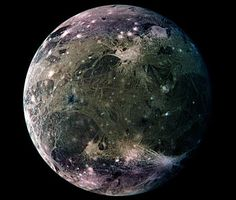 What does the largest moon in the Solar System look like? Ganymede, larger than even Mercury and Pluto, has a surface speckled with bright young craters overlying a mixture of older, darker, more cratered terrain laced with grooves and ridges