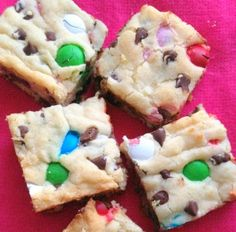 Loaded sugar cookie bars, made with premade sugar cookie dough and loaded with m and chocolate chips.